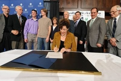 University President Susan Herbst signs UConn's climate action plan during the opening ceremony of CIMA on March 26, 2012.