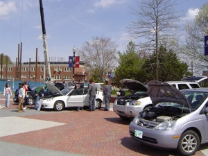 A display of alternative fuel vehicles during the 2005 Earth Day Spring Fling. From far left to right are the Honday Civic hybrid, the Honda Civic GX, the Ford Escape hybrid, and the Toyota Prius.